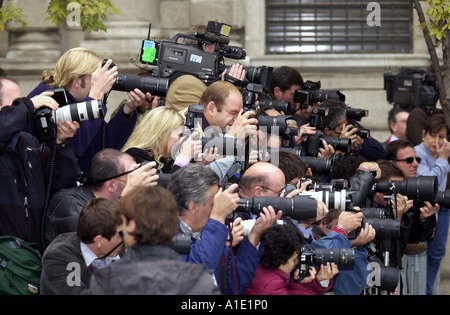 Press corps news photographers at work Milan Italy.The term paparazzi was used to describe a type of photographer - Stock Photo