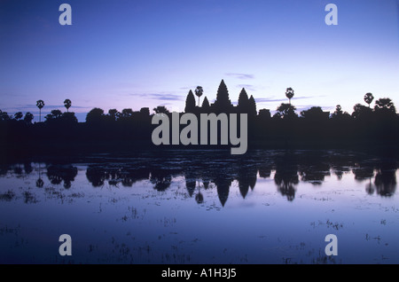 Angkor Wat in Cambodia seen reflected in its moat at dawn - Stock Photo