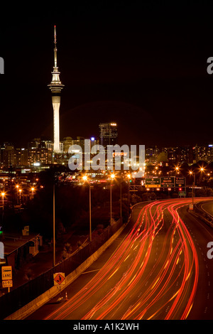 Northern Motorway and Skytower at night Auckland North Island New Zealand - Stock Photo