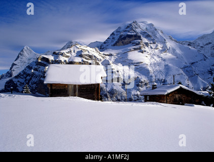 view from snowcovered mountain sheds near village of murren region of bernese highland swiss alpes switzerland - Stock Photo