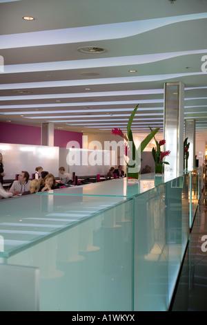 Second Floor Restaurant, Bar and Brasserie, Harvey Nichols, Manchester, 2003. Glass lighting tanks. - Stock Photo