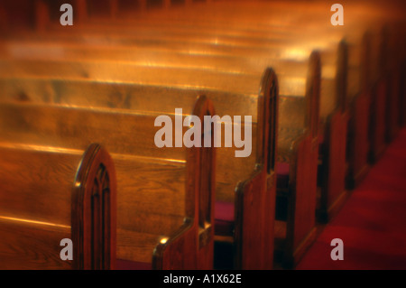 church pews in a row in an old new england church - Stock Photo
