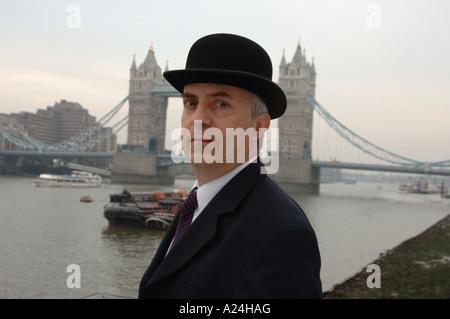 City gent at Tower Bridge, London - Stock Photo