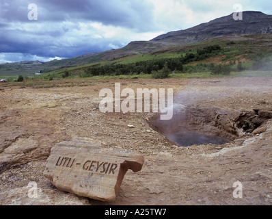 Litli Geyser and sign. One of many small geysers containing hot geothermal water.  Geysir Iceland - Stock Photo