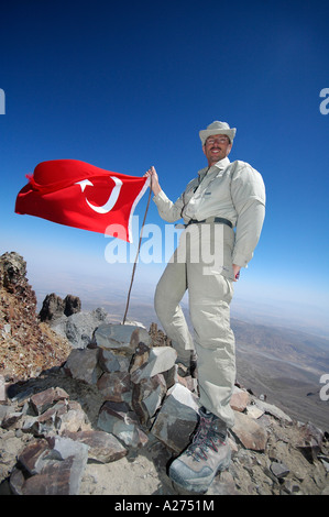 Proud trekker on the summit of Erciyas Dagi, Turkey, Asia - Stock Photo