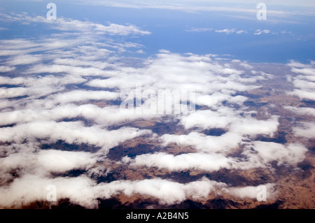 Aerial view of cloud formations over South Africa's Western Cape terrain, including the Great Rift Valley, close - Stock Photo