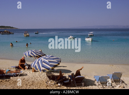 tourists on a small sandy beach of Antipaxos Island Greece - Stock Photo