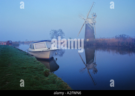 Moored by boat opposite Turf Fen Windpump on the River Ant Norfolk - Stock Photo