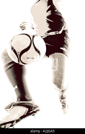 male age 20-25 playing football, the Image is a studio shot on a white background. - Stock Photo