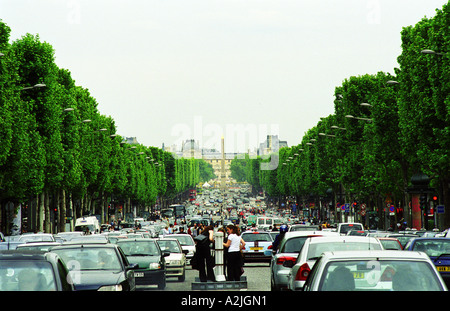 The Avenue des Champs Elysees in Paris with cars, looking down towards the Place de la Concorde with obelisk, the - Stock Photo