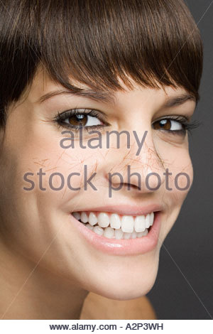 Girl with hair on her face - Stock Photo