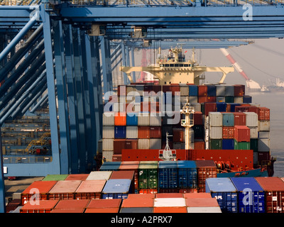 Container vessel at container terminal. Cargo operations in progress. - Stock Photo