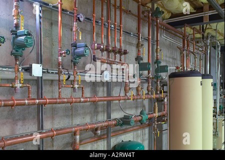 Metal Copper Water Pipes With Hot Water Heaters In Basement - Stock Photo