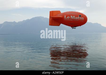 Le Matin airship over Lake Geneva Vevey Switzerland - Stock Photo