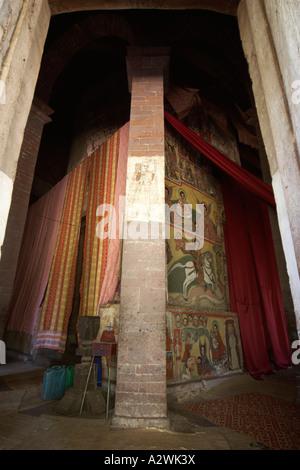 Old wall painting murals through door in Kebran Gabriel or Kibron Gebriel orthodox christian monastery church on - Stock Photo