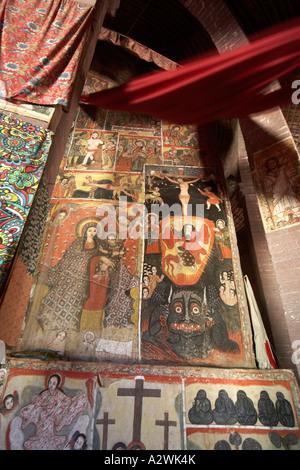 Restored old wall painting murals in Kebran Gabriel or Kibron Gebriel orthodox christian monastery church on Lake - Stock Photo