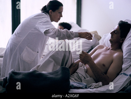 Socolitz, Bosnia, Sept 1992: wounded Bosnian Serb soldiers under treatment  from a nurse in Socolitz hospital - Stock Photo