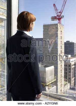Businesswoman looking at a construction site - Stock Photo