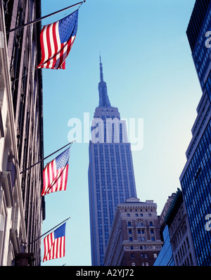 Empire State Building and American Flag, New York, USA - Stock Photo