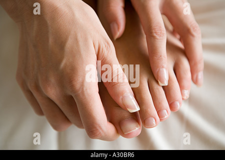 Hands massaging feet - Stock Photo