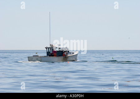 A Maine lobsterman works his traps on Muscongus Bay - Stock Photo