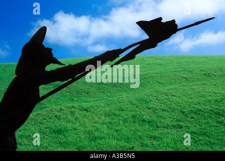 Silhouette Don Quijote on a background of green grass and blue sky - Stock Photo