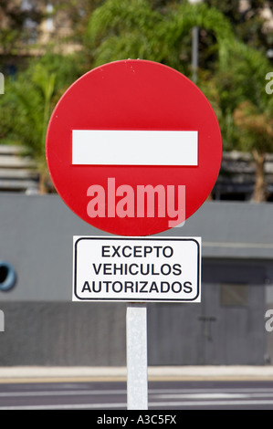 red and white bar no entry circular traffic sign with except authorised vehicles rectangular sign - Stock Photo