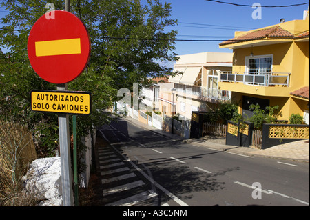 red and yellow bar no entry circular traffic sign with only trucks authorised yellow rectangular sign in spanish - Stock Photo