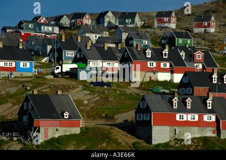 Colourful houses at a slope settlement Ammassalik Eastgreenland - Stock Photo