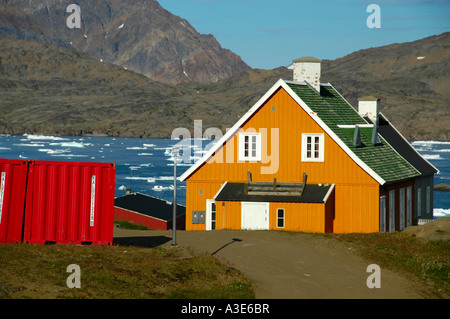 Colourful house at a fjord in settlement Ammassalik Eastgreenland - Stock Photo