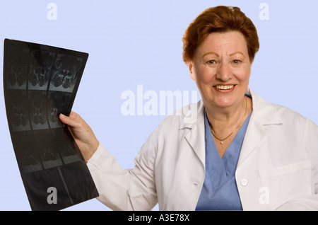 Woman physician holds the good news, an x-ray showing a positive diagnosis. - Stock Photo