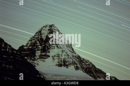 STAR TRAILS OVER MT. ASSINIBOINE, known as the Matterhorn of the Canadian Rockies - Stock Photo