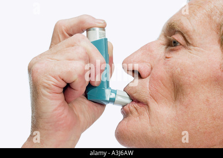 Man using inhaler - Stock Photo