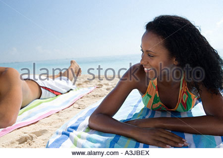 Woman lying on the beach - Stock Photo