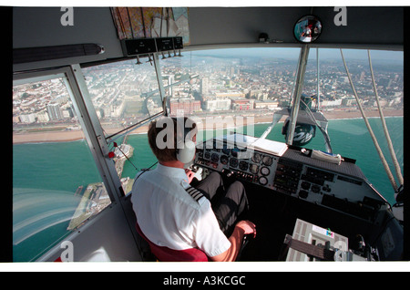 Police airship on surveilance duty over the south coast of England - Stock Photo