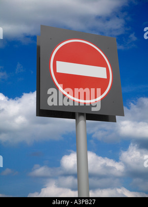 CIRCULAR RED AND WHITE ROAD TRAFFIC NO ENTRY SIGN AGAINST BLUE SKY BACKGROUND - Stock Photo