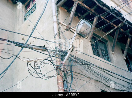 Complicated telephone wiring in Kathmandu in Nepal in Asia. Modern Life Urban City Third World Technology Technological - Stock Photo