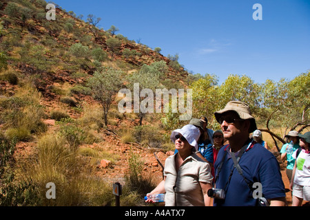 tourists on a walk in kings canyon in australia - Stock Photo