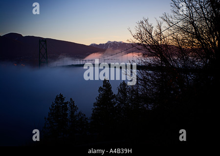 Lions gate bridge in the mist - Stock Photo