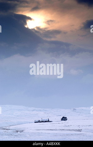Lone Cottage on Dava Moor in the dead of Winter. - Stock Photo