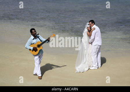 bride and groom dancing on beach - Stock Photo