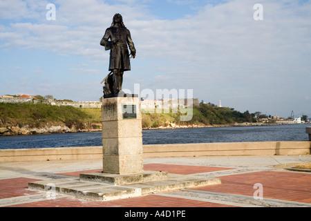 Statue of Pierre Le Moyne D'Iberville with Havana harbour and Fortezza San Carlos de la Cabana behind, Havana, Cuba - Stock Photo