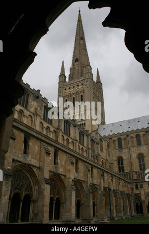 Norwich Cathedral in Norfolk seen through one of the many arches around its cloisters - Stock Photo