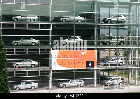 Daimler Chrysler House Showroom with Philosophical signs Munich Bavaria Germany - Stock Photo