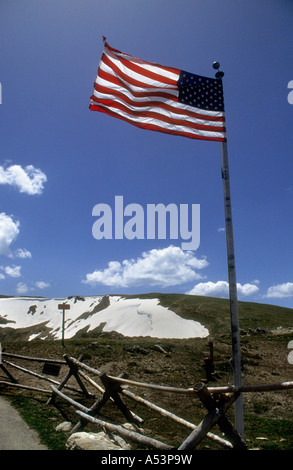 The Stars & Stripes Flag Flying High In The Rocky Mountains. - Stock Photo