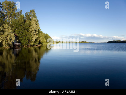 Calm lake Suontee surface in a warm Summer day , Finland - Stock Photo