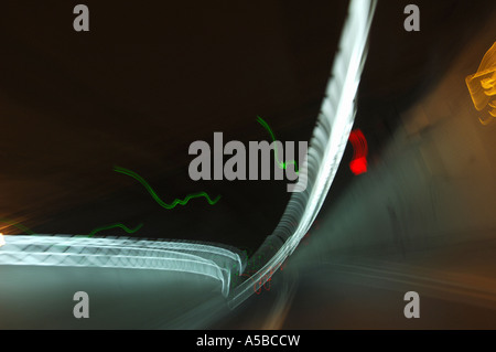 Traffic moving through car tunnel. - Stock Photo