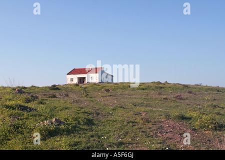 stone house in the middle of nowhere near Vila do Bispo Algarve Portugal - Stock Photo