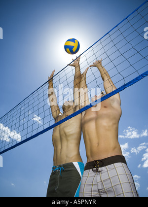 Jumping volleyball players - Stock Photo