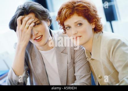 Businesswomen talking, close-up - Stock Photo
